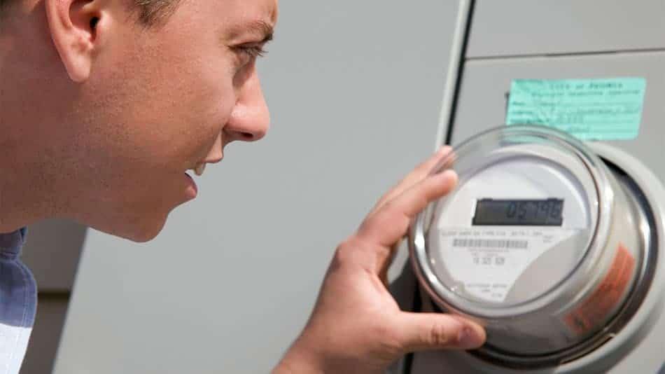 man checking power meter to take a reading