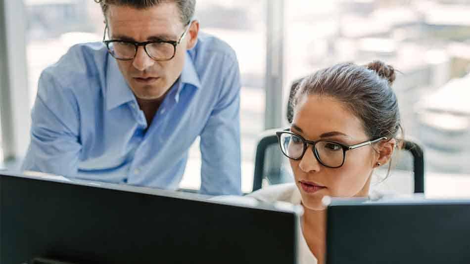 business workers using desktop computer