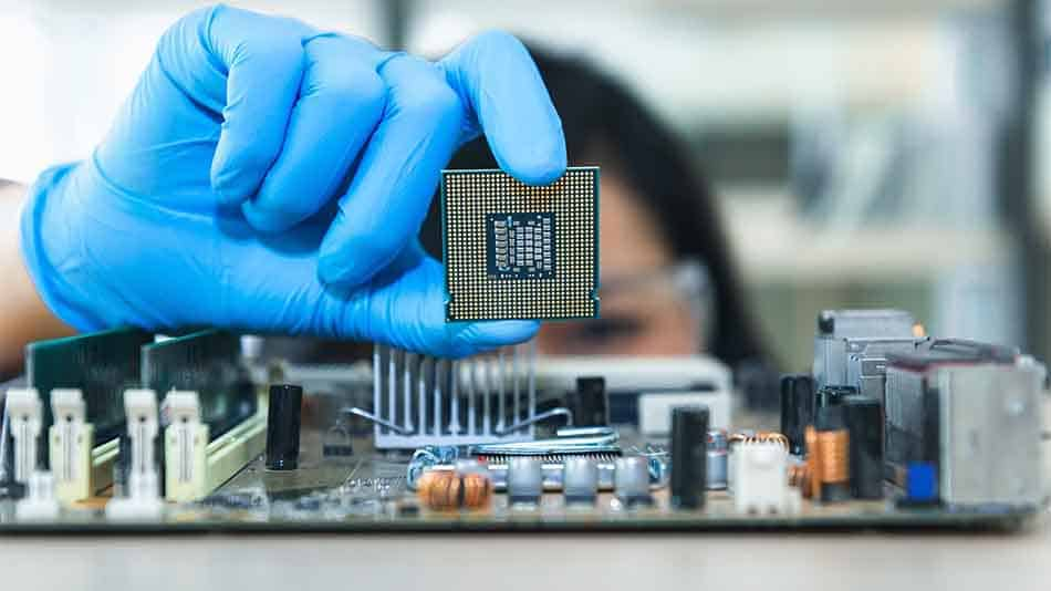 woman inspecting second hand cpu above motherboard