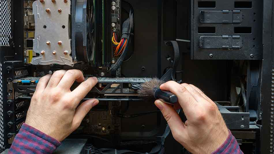 brushing hard components of a computer clean