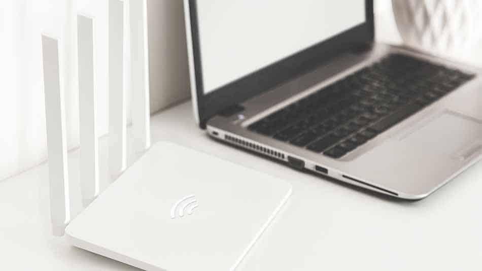 laptop next to wifi router
