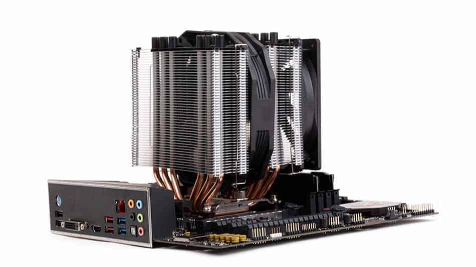 motherboard on table with cpu cooler