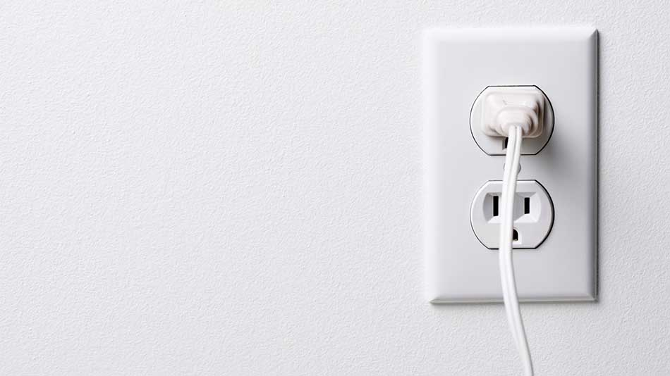 wall power socket with plug plugged into it